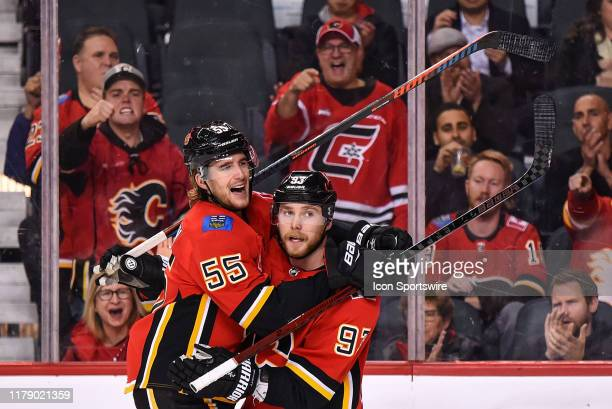 Calgary Flames Winger Sam Bennett celebrates a goal against the Florida Panthers with Calgary Flames Defenceman Noah Hanifin during the third period...
