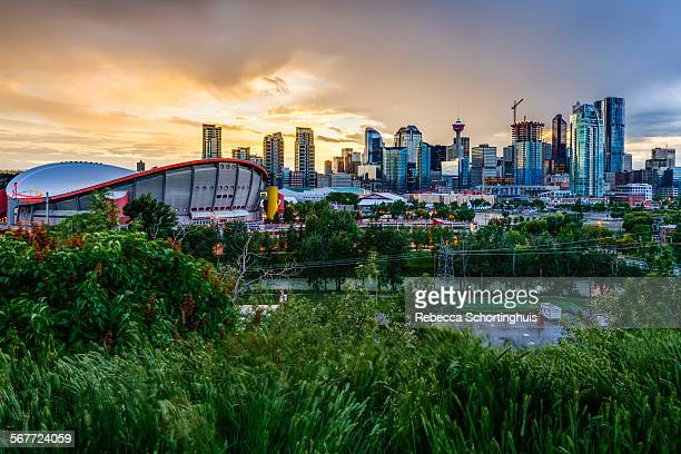 calgary skyline with dramatic cloudy sky - calgary stock pictures, royalty-free photos & images