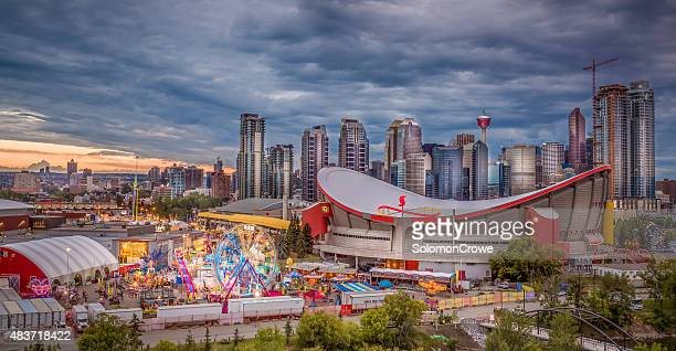 calgary stampede and city skyline - calgary stock pictures, royalty-free photos & images