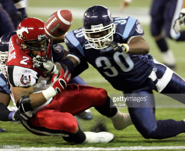 Calgary Stampeders Running Back Joffrey Reynolds fumbles near the Toronto goal line but it was recovered by a teammate in the end zone for a...
