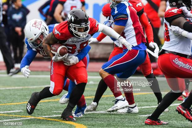 Calgary Stampeders Running back Terry Williams gets tackled during the Calgary Stampeders versus the Montreal Alouettes game on October 8 at Percival...