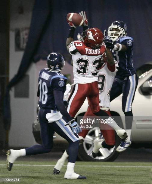 Calgary Stampeders safety Trey Young intercepts this pass in the end zone intended for Toronto's Bashir Levingston in CFL action at Rogers Centre in...