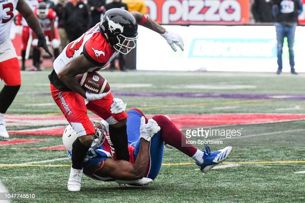 Calgary Stampeders Wide receiver Markeith Ambles gets tackled during the Calgary Stampeders versus the Montreal Alouettes game on October 8 at...