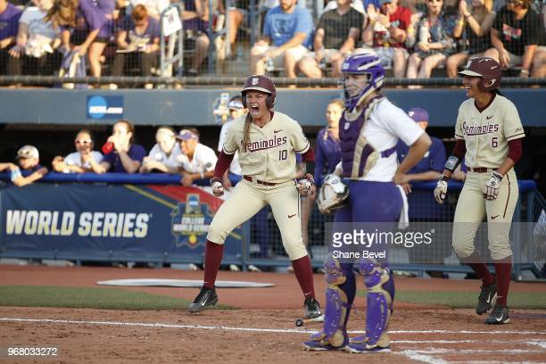 Cali Harrod of the Florida State Seminoles celebrates after scoring against the Washington Huskies during the Division I Women's Softball...