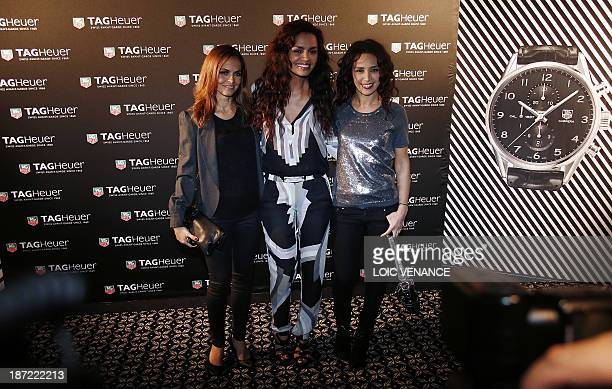 Cali Morales TV host Laurence Roustandjee and Aida Touihri pose during a photocall at an evening event celebrating TAG Heuer's Carerra watch 50 years...