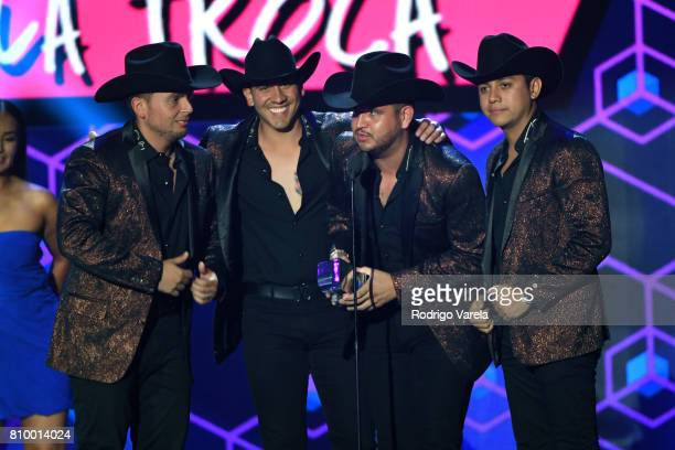 Calibre 50 accepts an award during Univision's 'Premios Juventud' 2017 Celebrates The Hottest Musical Artists And Young Latinos ChangeMakers at...