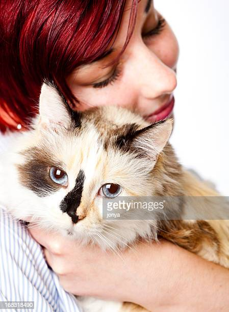 calico cat and redhead teenager