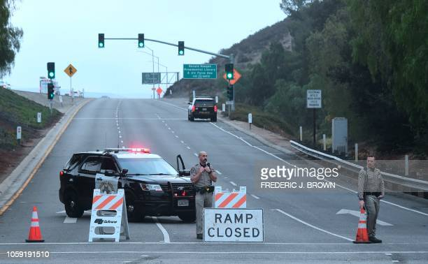 Califorina Highway Patrol officers man a roadblock at a highway onramp near the Borderline Bar and Grill in Thousand Oaks California on November 8...