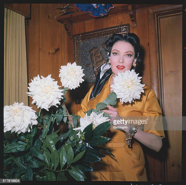 Actress Linda Darnell who performed in films by Vittorio de Sica, Jean Cocteau, and John Cromwell, with beautiful flowers.