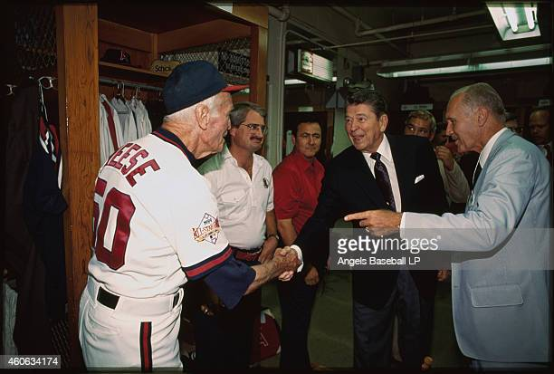 California Angels coach Jimmie Reese shakes hands with President of the United States Ronald Reagan in the clubhouse before the 1989 MLB AllStar Game...
