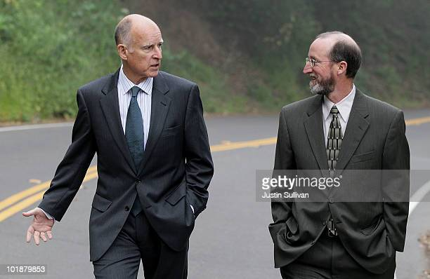 California Attorney General and democratic candidate for governor Jerry Brown talks with his campaign manager Steven Glazer as he walks home after...