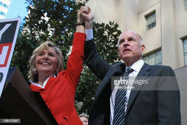 California Attorney General and democratic gubernatorial candidate Jerry Brown and US Sen Barbara Boxer raise their arms during a campaign rally at...