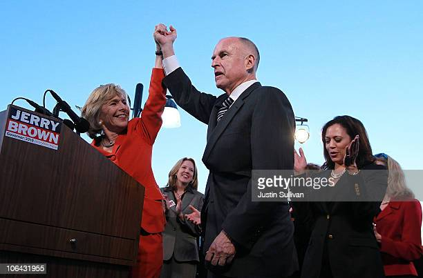 California Attorney General and democratic gubernatorial candidate Jerry Brown and US Sen Barbara Boxer raise their arms during a campaign rally to...