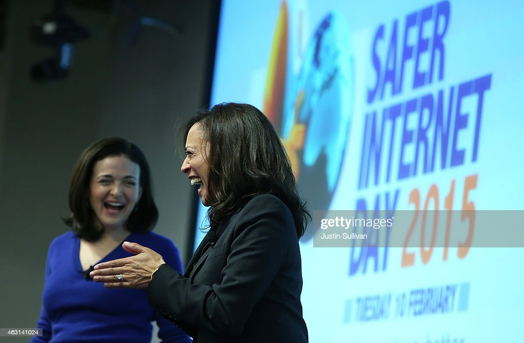California Attorney General Kamala Harris (R) and Facebook COO Sheryl Sandberg share a laugh on stage during a Safer Internet Day event at Facebook headquarters on February 10, 2015 in Menlo Park, California. Harris delivered the keynote speech at the event, designed to promote safe, effective use of the internet and mobile technology. Safer Internet Day is celebrated annually in more than 100 countries on the the second Tuesday in February.