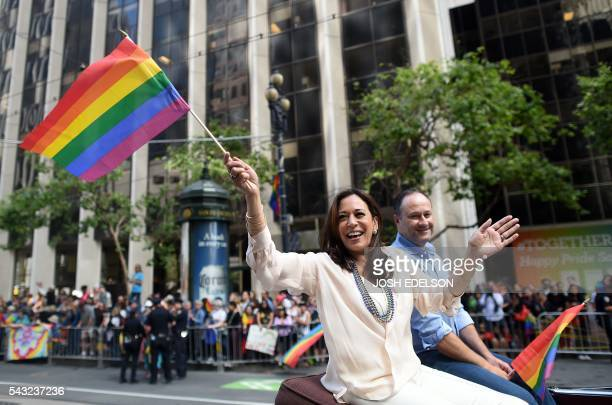 California Attorney General Kamala Harris waves a rainbow flag while participating in the San Francisco Pride parade in San Francisco California on...