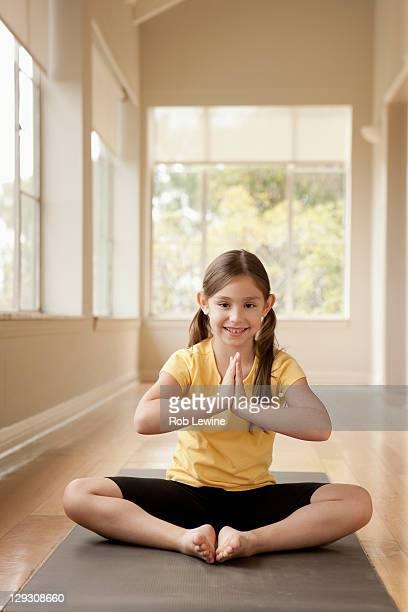 USA, California, Beverley Hills, Girl (6-7) practicing yoga