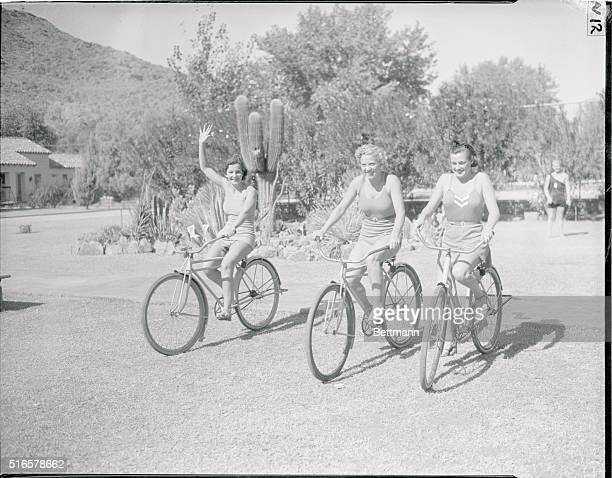 Bicycle Beauties Jennie Cramer Georgia Coleman and Eleanor Holm swimming and diving champions strengthen the leg muscles a little on a bicycle...