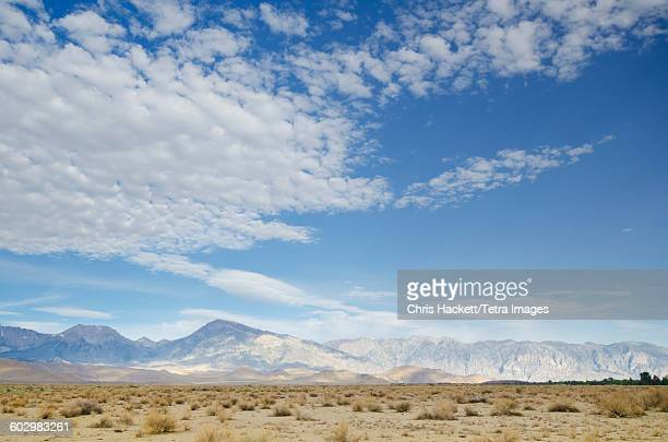 usa, california, bishop, mountain landscape and cloudy sky - hackett stock photos and pictures