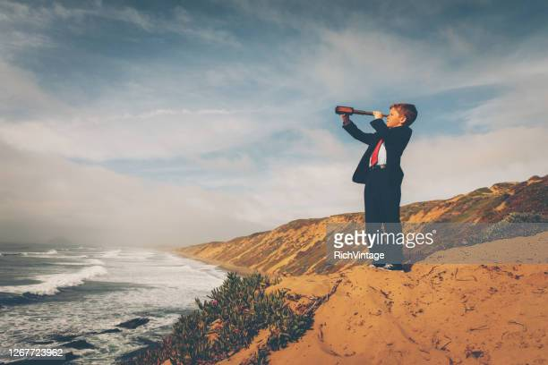 california business boy with telescope - adult imitation stock pictures, royalty-free photos & images