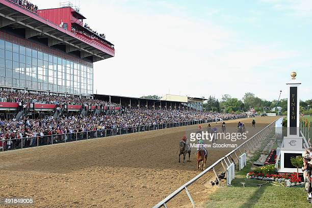 California Chrome ridden by Victor Espinoza crosses the finishline to win the 139th running of the Preakness Stakes at Pimlico Race Course on May 17...