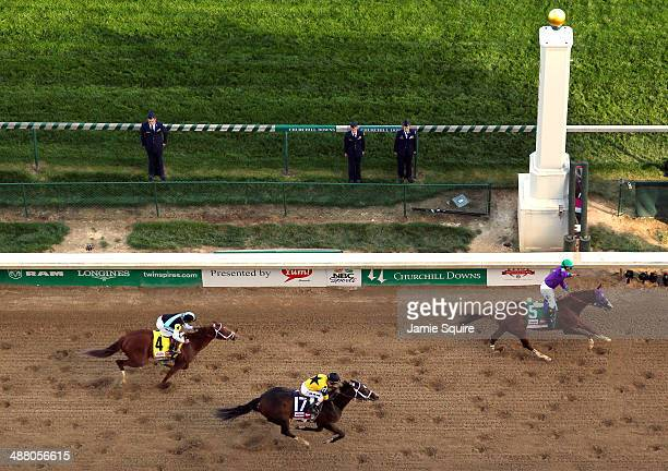 California Chrome with Victor Espinoza up crosses the finish line ahead of Commanding Curve and Danza to win the 140th running of the Kentucky Derby...