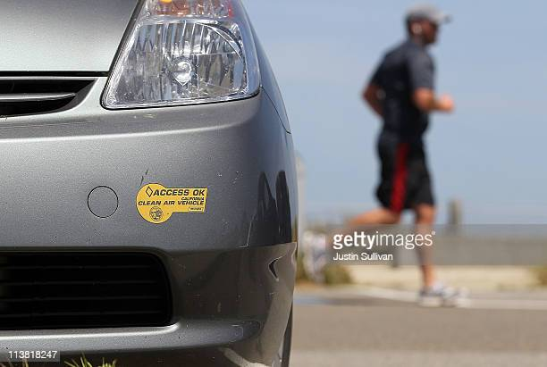 California clean air vehicle sticker is seen on the front bumper of a Toyota Prius on May 6 2011 in San Rafael California The California DMV...