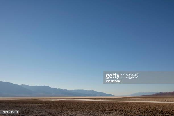 usa, california, death valley, badwater basin - horizon over land stock photos and pictures