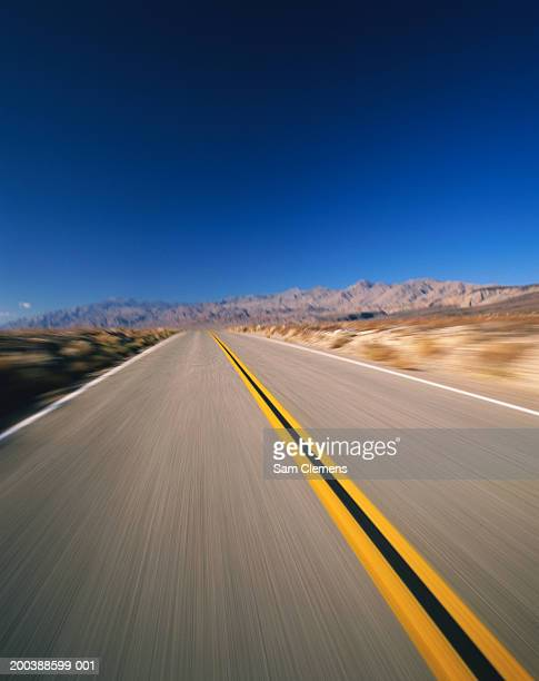 USA, California, Death Valley Highway (blurred motion)
