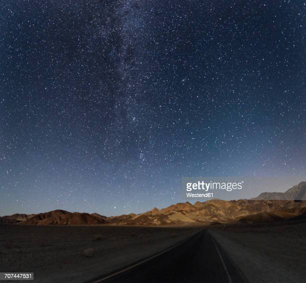 USA, California, Death Valley, night shot with stars and milky way over road to Zabriskie Point