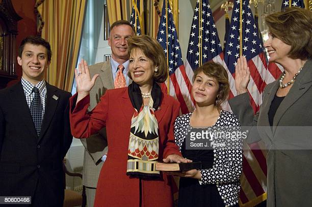 California Democrat Jackie Speier during a mock swearing in with Speaker Nancy Pelosi far right With her are son Jackson Dennis husband Barry Dennis...