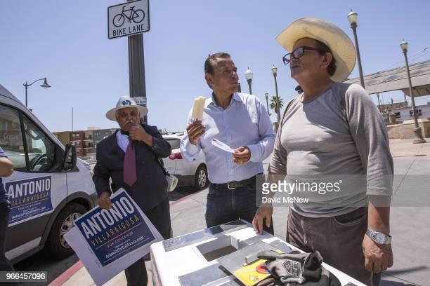 California Democratic gubernatorial candidate Antonio Villaraigosa buys a frozen Mexican paleta from a street vender at Mariachi Plaza in his...