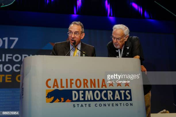 California Democratic Party special counsel Coby King left with outgoing party Chairman John Burton reads party bylaws to delegates after they took...