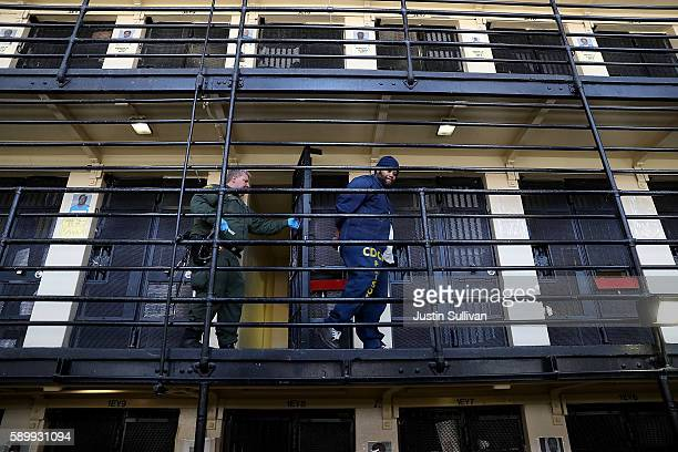 California Department of Corrections and Rehabilitation officer escorts a condemned inmate from his cell at San Quentin State Prison's death row on...