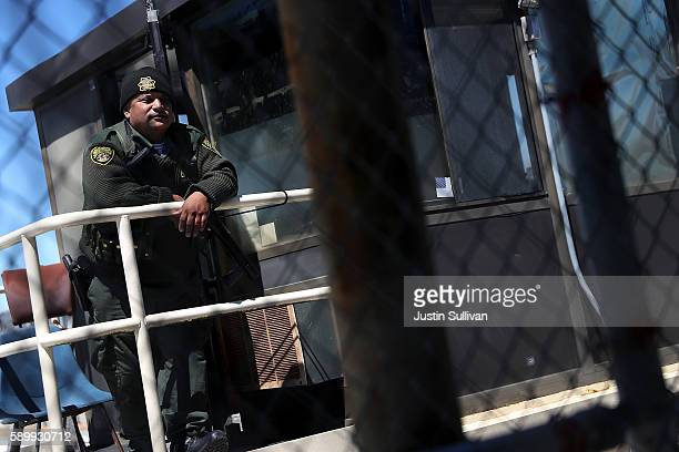 California Department of Corrections and Rehabilitation officer stands guard in a housing block at San Quentin State Prison on August 15 2016 in San...