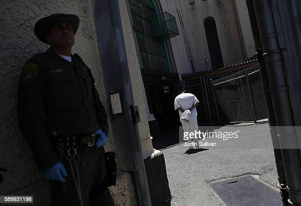 California Department of Corrections and Rehabilitation officer looks on as a condemned inmate walks back to San Quentin State Prison's death row on...