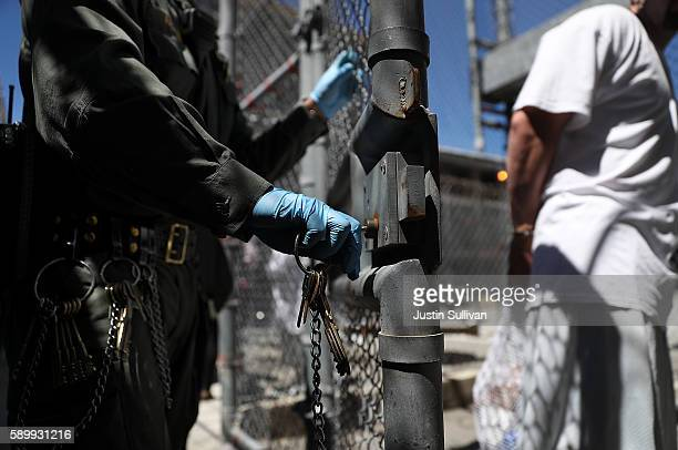 California Department of Corrections and Rehabilitation officer opens the gate for a condemned inmate who is leaving the exercise yard at San Quentin...