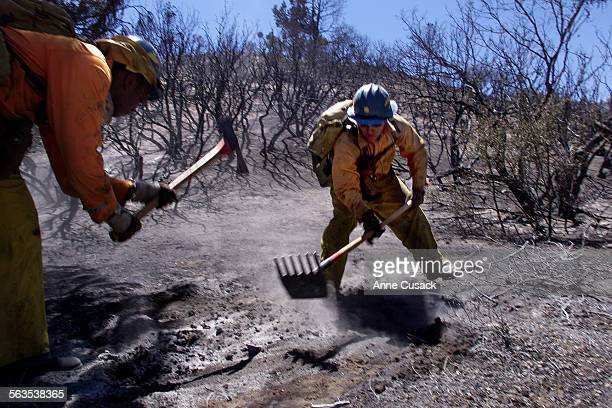 California Department of Corrections crew members hit hot spots in the 1000 acre brush fire in the Tejon Pass near Gorman It is about 20 per cent...