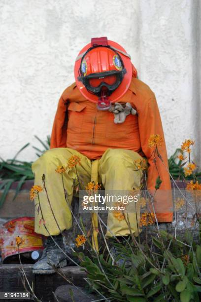 California Department of Corrections firefighter takes a rest January 12 2005 in La Conchita California Ten people have been reported as found dead...