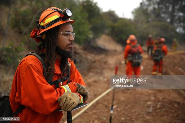 California Department of Corrections inmate fire crews monitor the Detwiler Fire on July 19 2017 in Mariposa California More than 1400 firefighters...