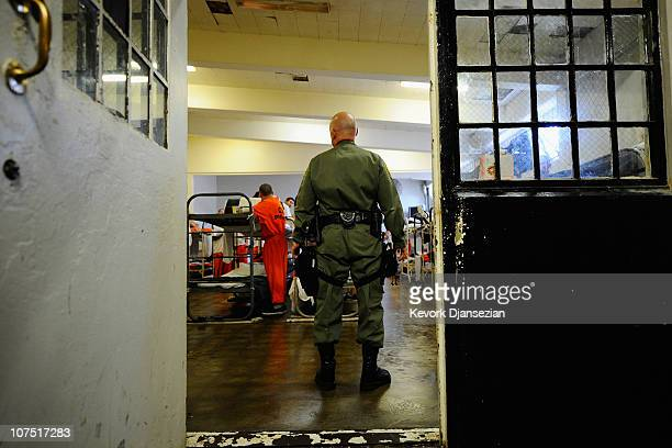 California Department of Corrections officer speaks to inmates at Chino State Prison in the dayroom of Sycamore Hall that was modified to house...