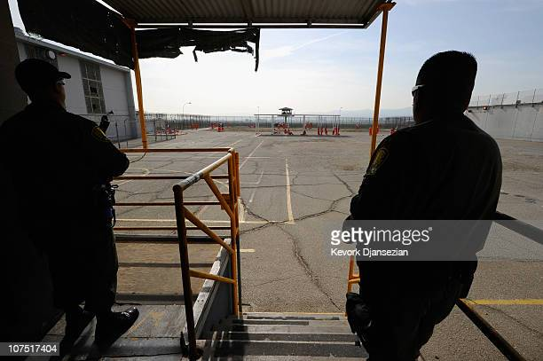 California Department of Corrections officers looks on as inmates at Chino State Prison exercise in the yard December 10 2010 in Chino California The...