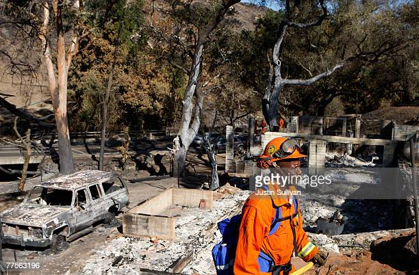 California Department of Corrections prison inmate firefighter surveys the area around a destroyed home October 30 2007 in Ramona California Clean up...