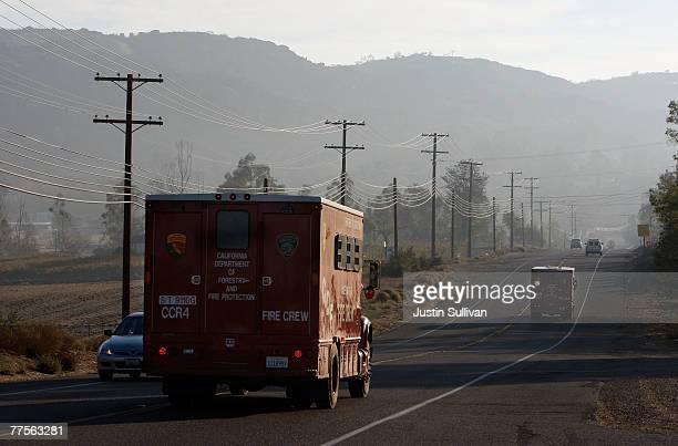 60 Top Residents Return To Neighborhoods As Wildfires