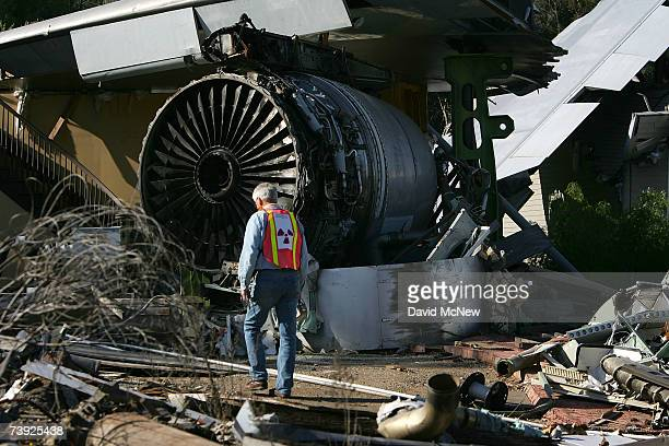 California Department of Health Services Health Physicist Robert Greger prepares the site with sources of lowlevel radiation for an exercise...