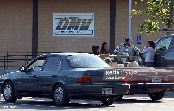 California Department of Motor Vehicles customers sit in the parking lot after finding out that the DMV is closed July 10 2009 in Corte Madera...