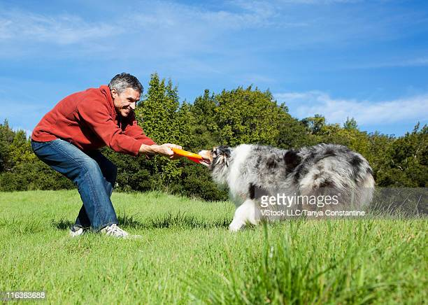 USA, California, Fairfax, Man playing with Border Collie in park