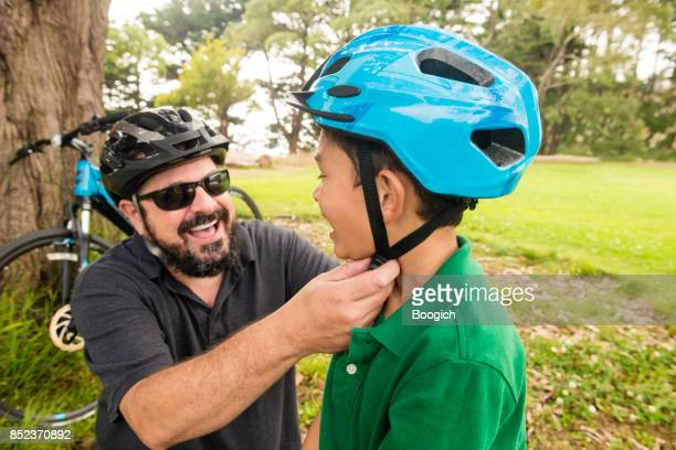 California Father Puts Helmet on Son Before Riding Bikes Outdoors
