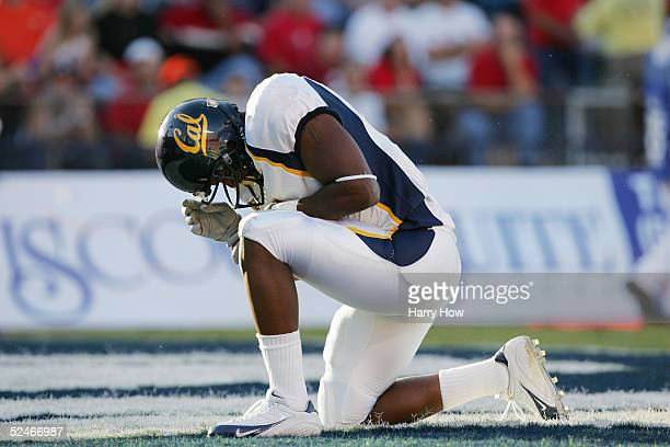 California football player kneels in the end zone while facing Arizona at Arizona Stadium on October 23, 2004 in Tucson, Arizona. Cal defeated...