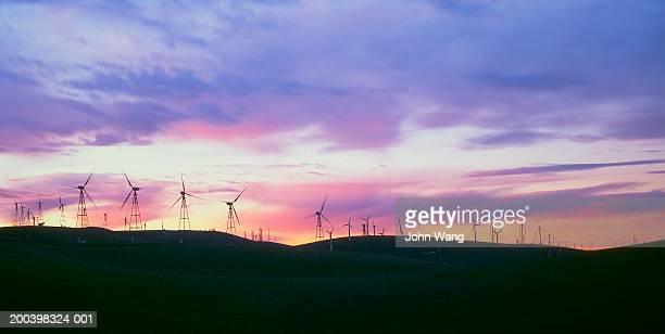 USA, California, Fresno, wind turbines at sunrise