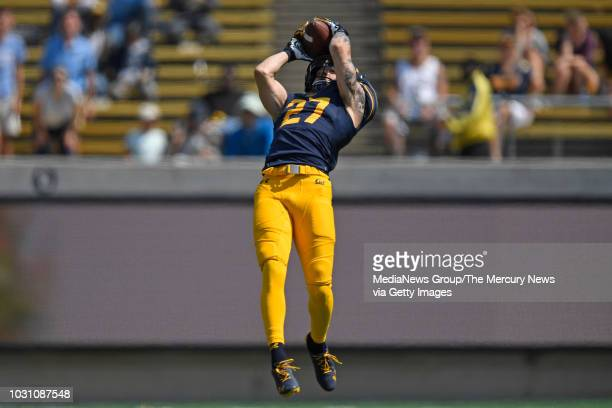 California Golden Bears' Ashtyn Davis intercepts a pass thrown by North Carolina Tar Heels quarterback Nathan Elliott during the second quarter of...
